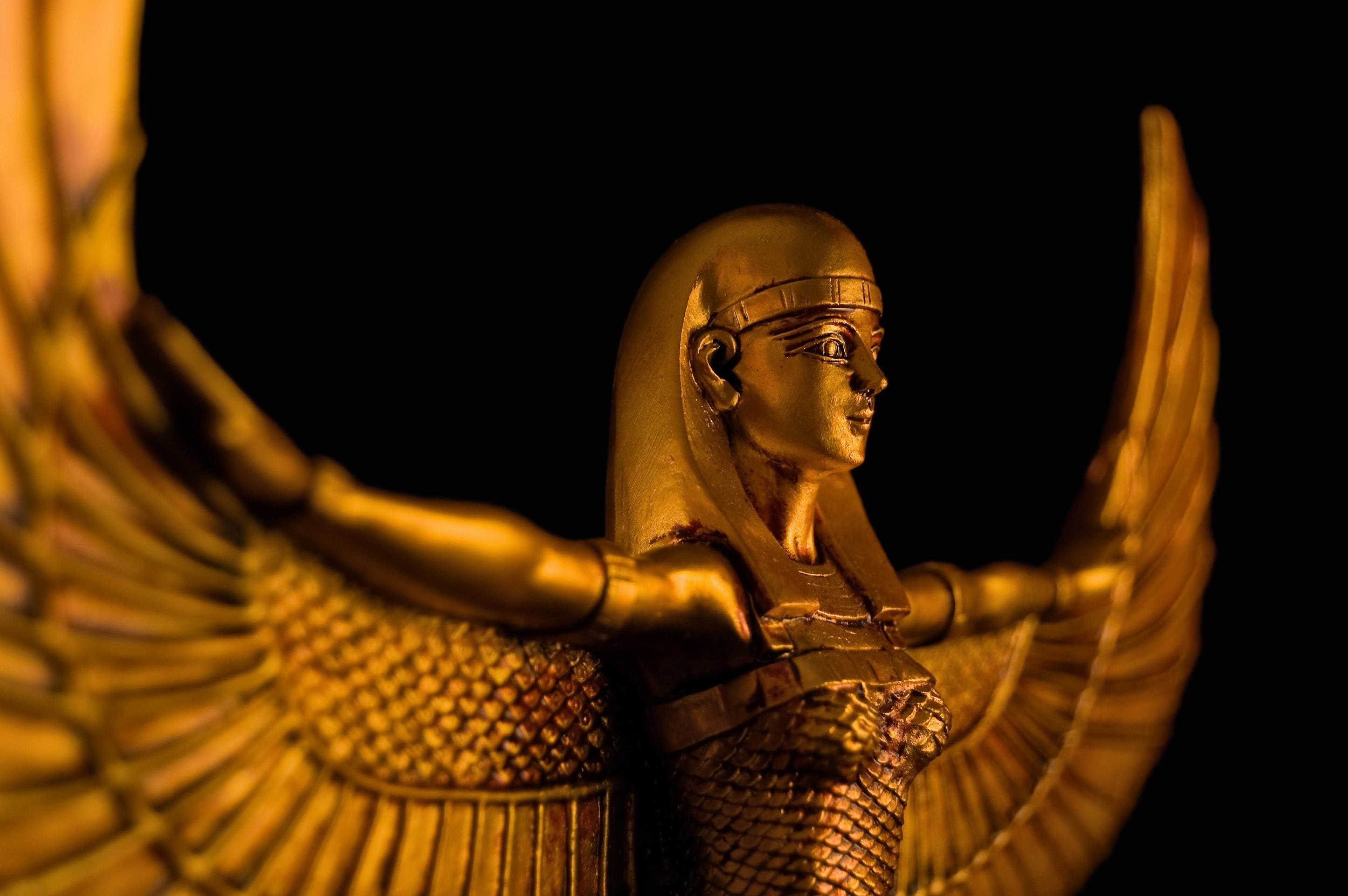 A gold statue of egyptian goddess