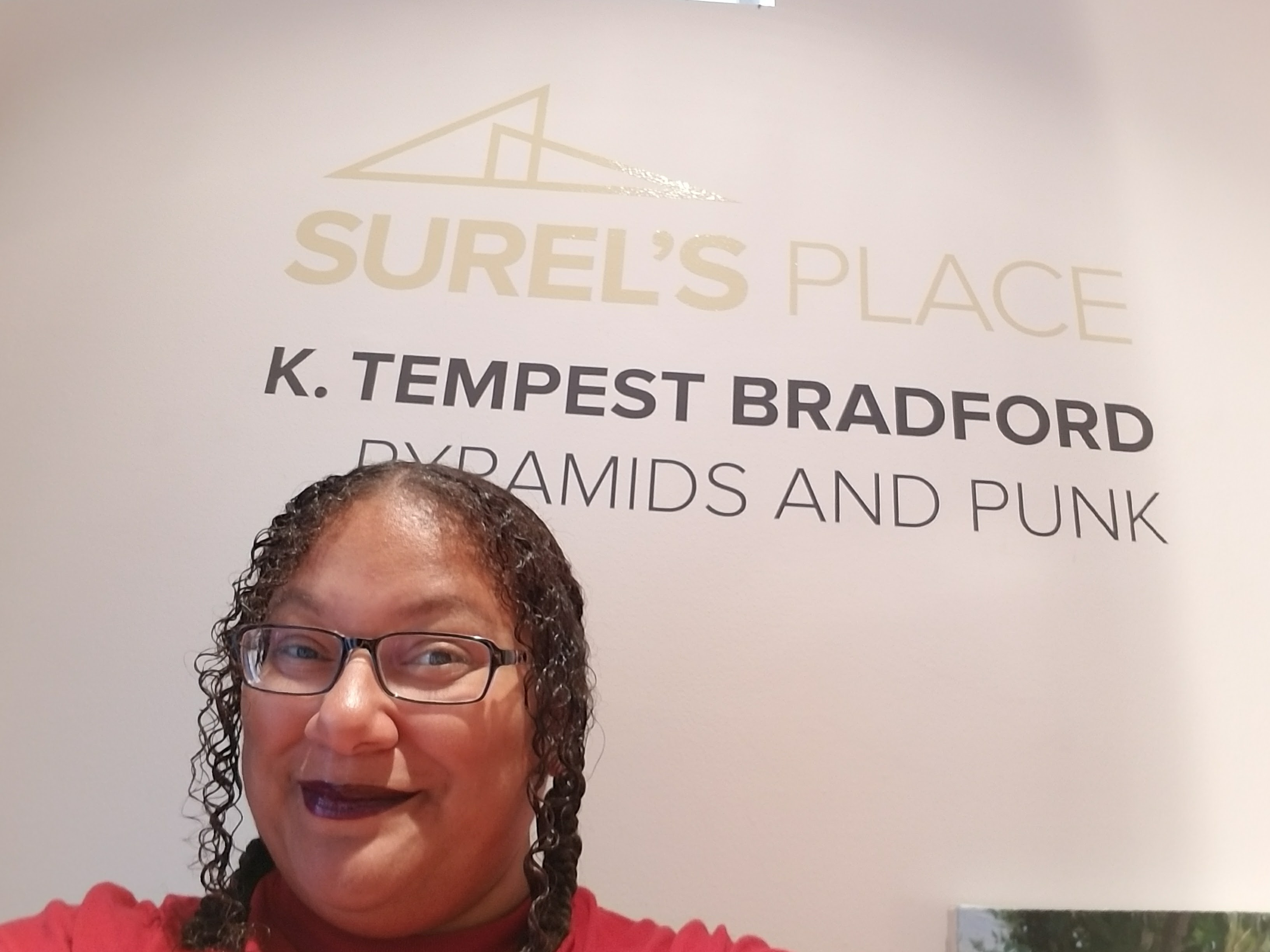 Tempest in front of Surel's Place sign